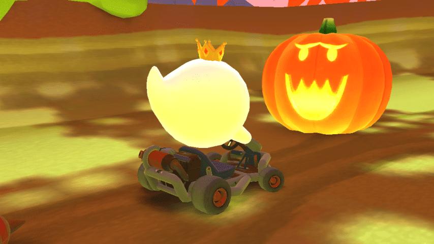 Re Boo di fronte a una zucca di Halloween | Mario Kart Tour